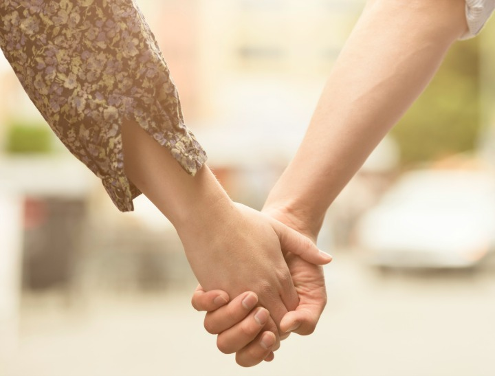 couple hold hands istock feat