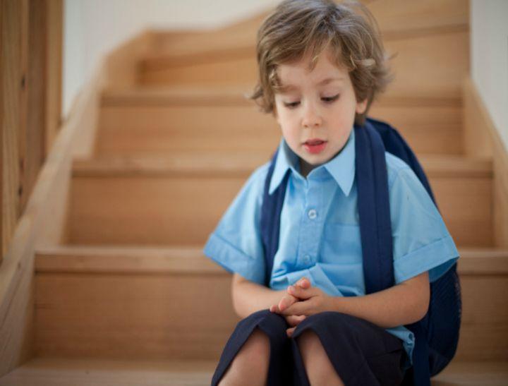 boy first day school sad FI