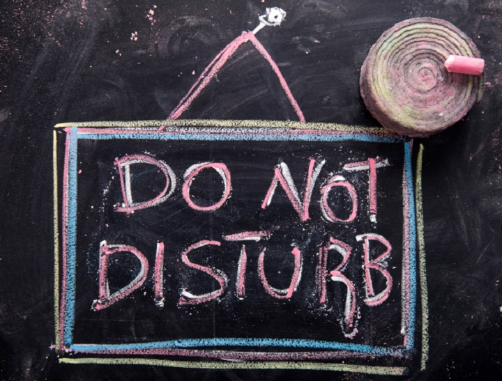 Graphic representation of the word, do not disturb, written with chalk on blackboard
