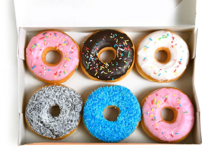tempting box full of delicious donuts different flavors toppings