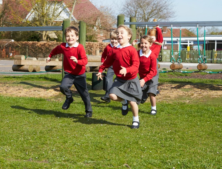 Elementary School Pupils Running Near Climbing Equipment